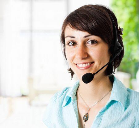 call us: Portrait of a beautiful customer representative smiling