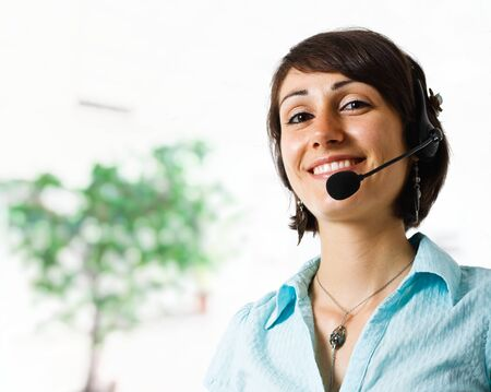 Portrait of a beautiful customer representative smiling photo