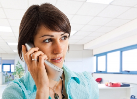 contact us: Portrait of a beautiful customer representative talking on the phone