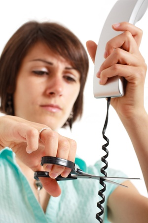 telephone cable: Portrait of a stressed woman cutting a telephone cable