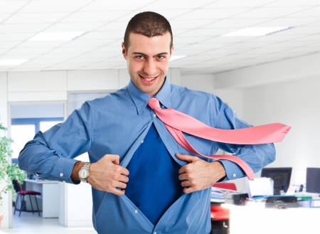 Businessman tearing his shirt like a superhero photo