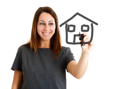 Woman drawing an house on the screen photo