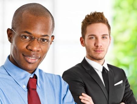 Portrait of two handsome businessmen photo
