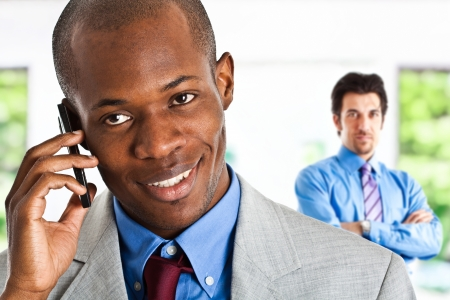 Portrait of a businessman talking on the phone Stock Photo - 14598669