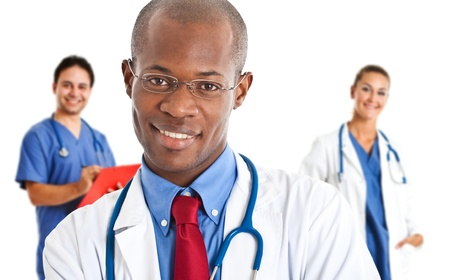 Portrait of an handsome smiling doctor Stock Photo - 14598531