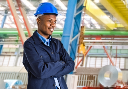 Smiling engineer at work in a factory photo