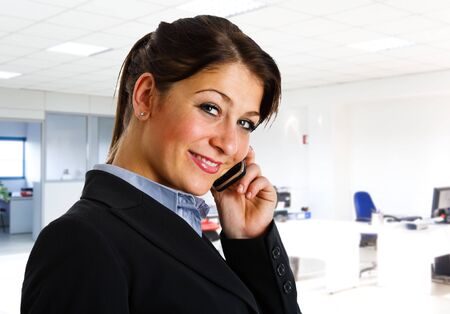 Beautiful smiling businesswoman talking on the phone Stock Photo - 14598540