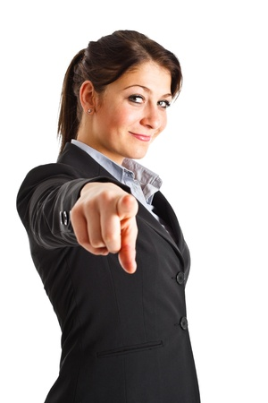 Beautiful businesswoman pointing her finger at you photo