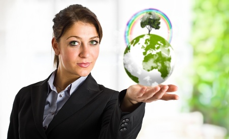Beautiful woman holding the earth in her hand photo