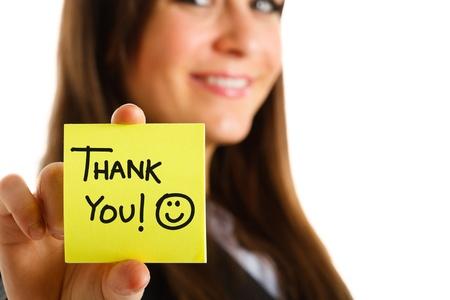 gratitudine: Donna di affari che mostra un post-it per ringraziarvi