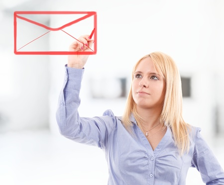 Young woman drawing a sealed envelope on the screen photo
