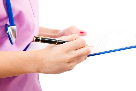 Young nurse writing medical records Stock Photo - 14598479