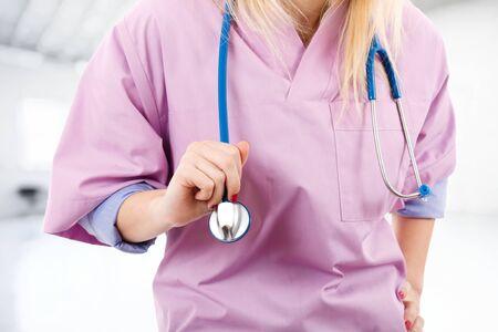Nurse holding a stethoscope Stock Photo - 14598592