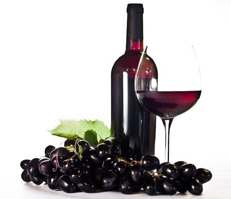 Red wine  bottle, glass and black grapes photo