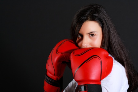 Portrait of a young girl with boxing gloves photo