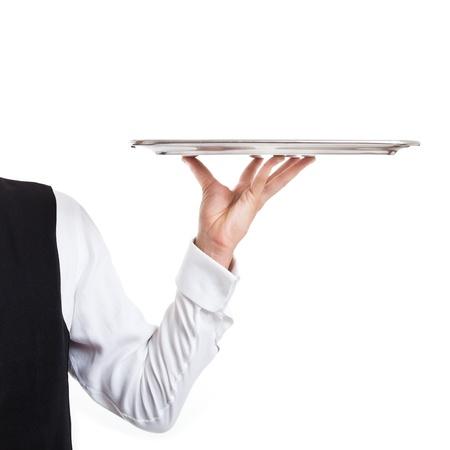 mesero: Camarero profesional sosteniendo un plato vac�o aislado en blanco Foto de archivo