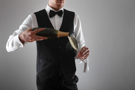Portrait of a waiter holding a champagne bottle Stock Photo - 14663524