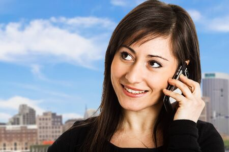 Portrait of a beautiful woman talking on the phone Stock Photo - 14663450