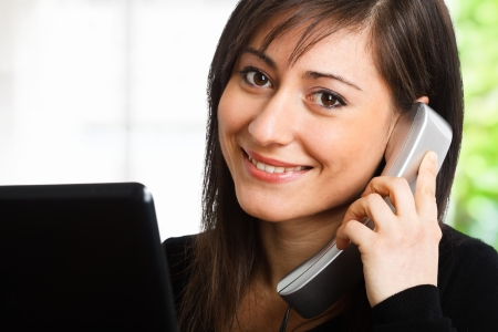 Portrait of a woman using a telephone Stock Photo - 14663489