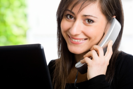 Portrait of a beautiful customer representative Stock Photo - 14663483