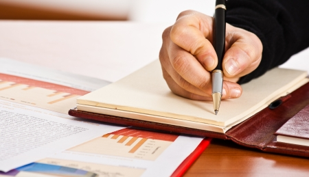 Person handwriting notes in the office Stock Photo - 14663433