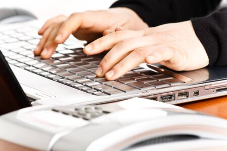 Worker using a laptop computer Stock Photo - 14663473
