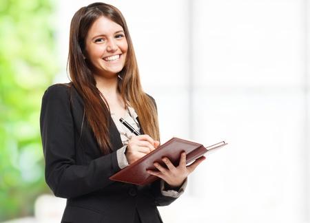 profesor alumno: Retrato de una mujer que escribe las notas