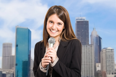 tv reporter: Portrait of a woman speaking in a microphone