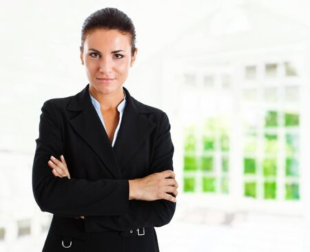 Portrait of a beautiful businesswoman in her office Stock Photo - 14748473