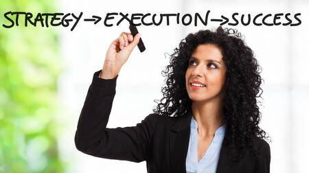 Businesswoman writing a motivational concept on the screen Stock Photo - 14748746