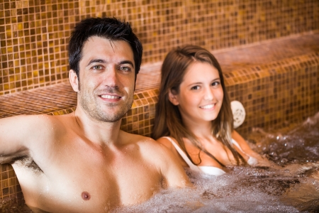 Portrait of a young couple relaxing in a spa photo