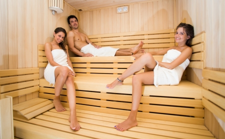 Group of people doing a sauna bath in a steam room photo