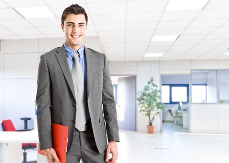 Portrait of a smiling businessman in his office photo