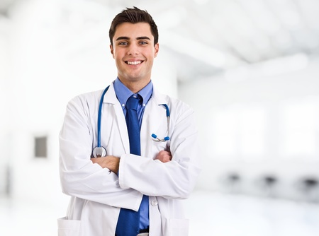 Portrait of an handsome smiling doctor Stock Photo - 14748225