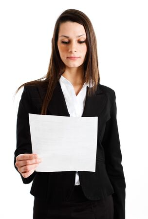 Businesswoman reading a business document photo