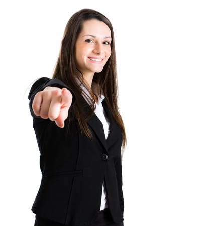 Smiling businesswoman pointing her finger at you photo