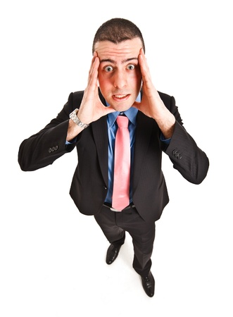 apprehension: Portrait of a businessman with a funny facial expression Stock Photo
