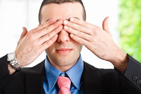 shutting: Man shutting his eyes Stock Photo