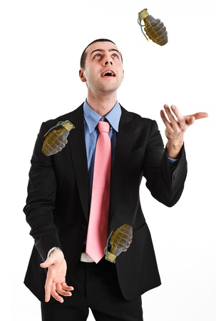 Business man juggling hand grenades photo