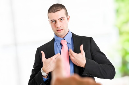 Boss pointing the finger to an employee photo