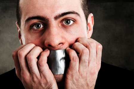 censorship: Man with mouth covered by tape Stock Photo