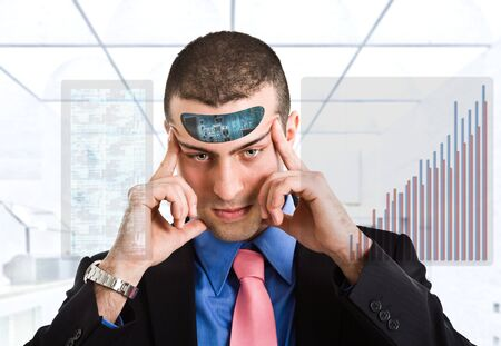 Businessman using his electronic mind photo