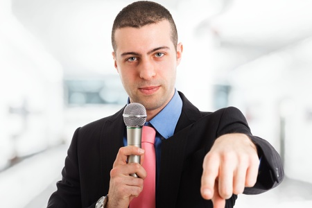 newsreader: Portrait of a man speaking in a microphone Stock Photo