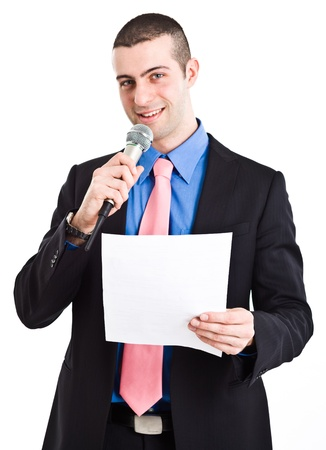 Portrait of a man speaking in a microphone. Isolated on white photo