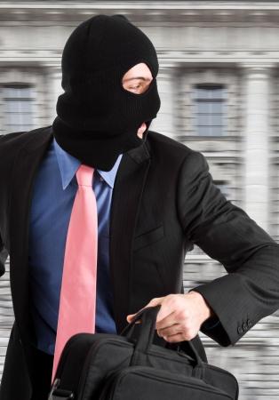 Portrait of a burglar running with a handbag Stock Photo - 14748711
