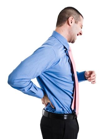 dolor de espalda: El hombre sufre de un dolor de espalda. Aislado en blanco Foto de archivo