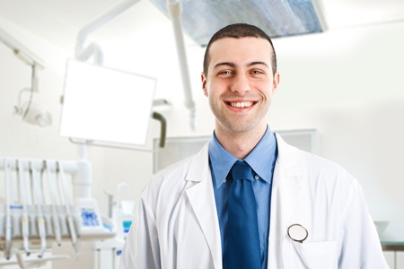 Portrait of an handsome smiling dentist Stock Photo - 14748374
