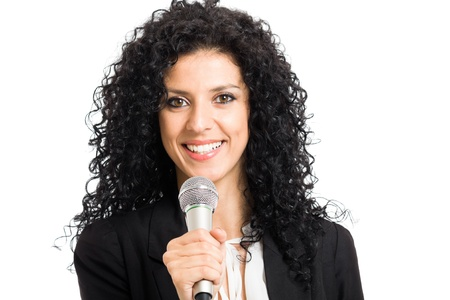 Portrait of a woman speaking in a microphone. Isolated on white photo
