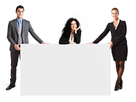 Business people showing a blank sign photo