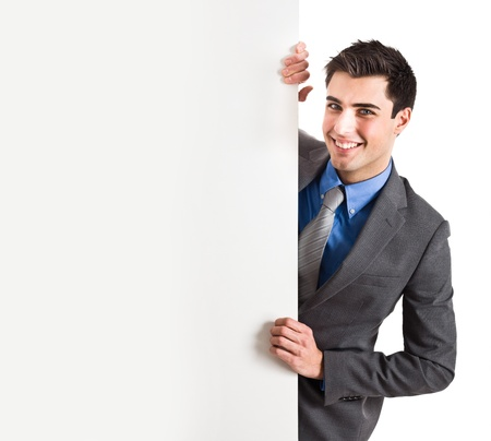 Handsome man showing a blank board Stock Photo - 14870572